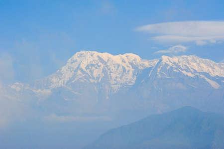 apogee: Big white snow mountains against blue sky ,Nepal Stock Photo