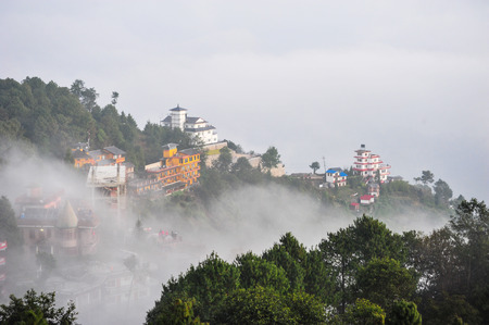 apogee: City in the fog on the forest mountains in NakagodNepal Stock Photo
