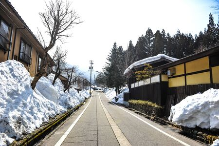Snow and Local road in country village of Japan photo