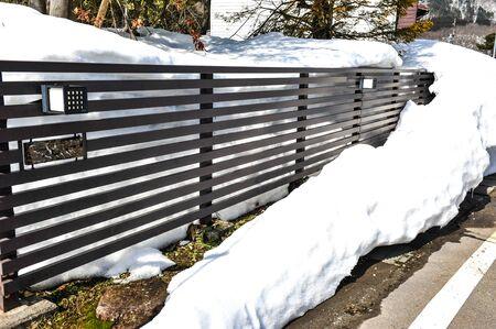 frost bound: Fence near street in Japan