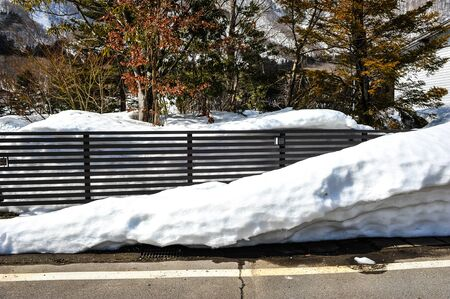 frost bound: Metal fence in the snow