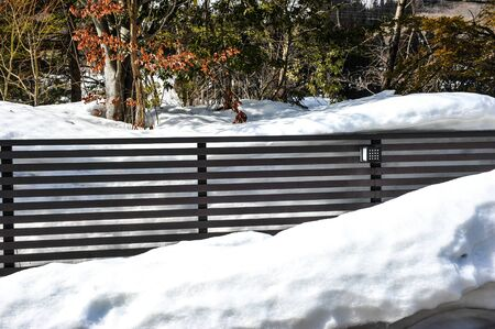 frost bound: Modern metal fence in the snow
