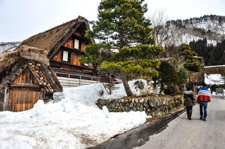 shirakawa go: A tourist walks of visited old wooden house in Shirakawa Go village ,Japan