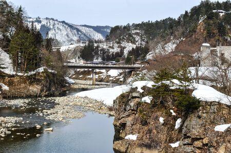 shirakawa go: Partially frozen river in Shirakawa Go village, Japan