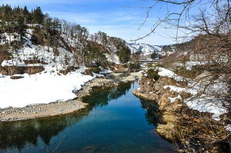 shirakawa go: Beautiful stream and snow on the stone cliff in Shirakawa Go village, Japan