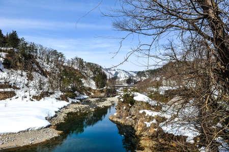 shirakawa go: Beautiful stream and snow on the stone in Shirakawa Go village, Japan