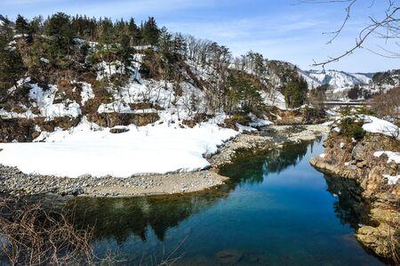 shirakawa go: Beautiful lake and snow on the stone in Shirakawa Go village, Japan