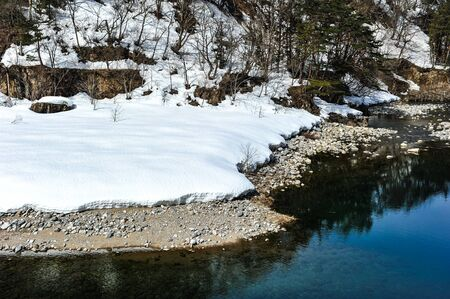 floating bridge: Beautiful lake and snow on the stone in Japan