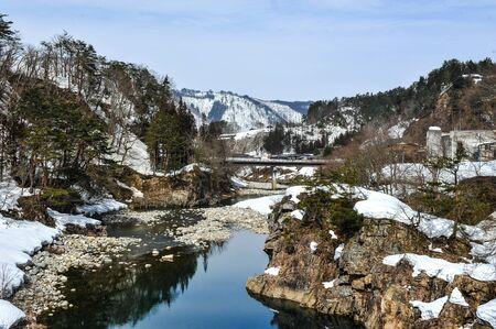 shirakawa go: Ice stream and snow-covered grasses in the Shirakawa Go village ,Japan