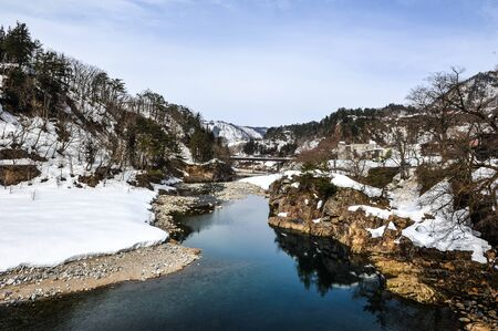 shirakawa go: Snow covered on the stream in Shirakawa Go village ,Japan Stock Photo