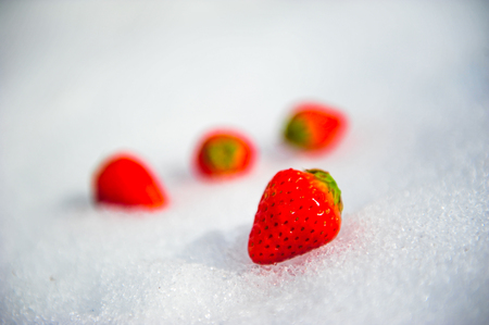 Fresh strawberries on crytal of snow