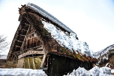 gabled house: Old wooden house in japanese style and white snow