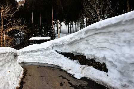 shirakawa go: A layer of snow walls from melting