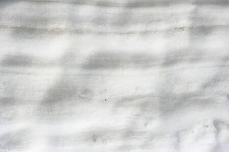 shrinkage: White snow wall