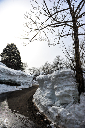 shrinkage: Hole of snow wall near the road in Japan Stock Photo