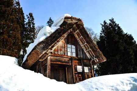 ancient japanese: Ancient japanese style house on snowy mountains Editorial