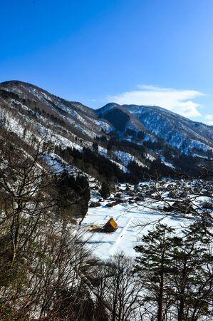 shirakawa go: Panorama view of World Heritage Shirakawa Go village against blue sky Editorial