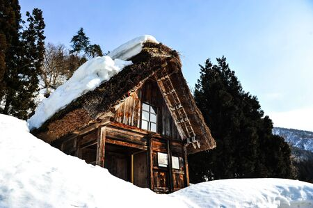 gifu: Beautiful old wooden house in forest winter weather of Japan Editorial