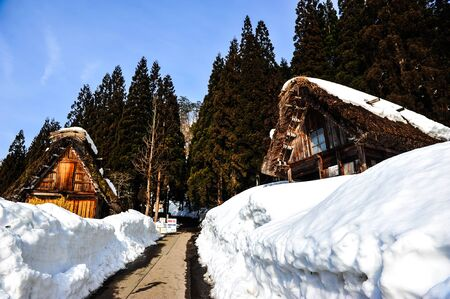 shirakawa go: Road to the old wooden house on snowy mountain in Shirakawa Go village