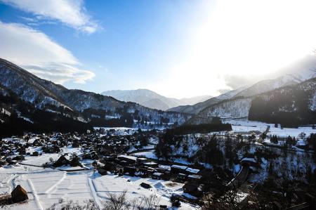 shirakawa go: Silhouette view of shirakawa Go village against sunlight effect