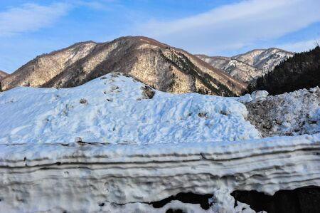 Layer of white snow and snowy mountains Stock Photo