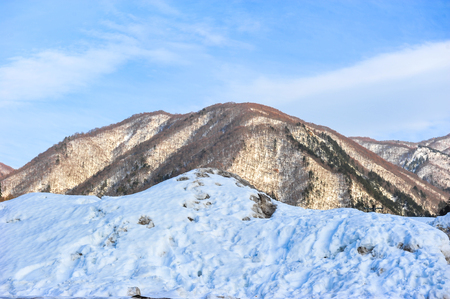 the snowy mountains: Silver of sunlight on top of the snowy mountains Stock Photo