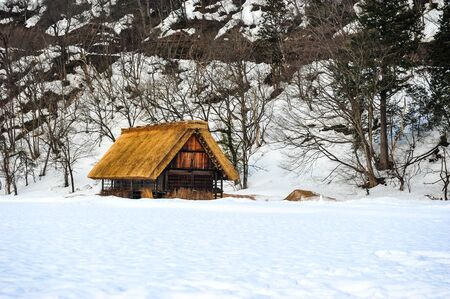 Texture of white snow and old wooden house in Shirakawa Go village