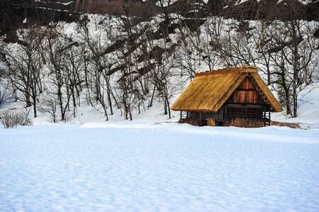 shrinkage: Garth snow and old wooden house in winter season of Japan Editorial