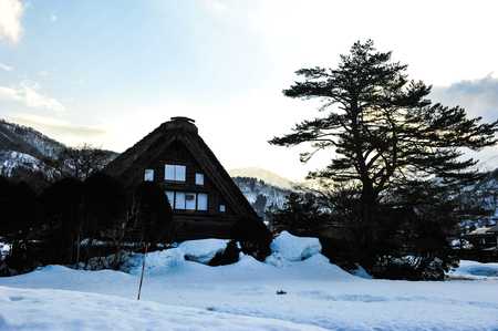 garth: Sunlight effect on the garth snow and old wooden house in Japan