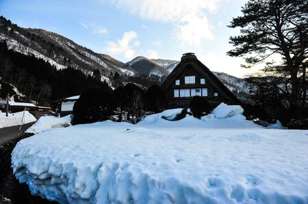 shrinkage: Silhouette of garth snow in Shirakawa Go village ,Japan