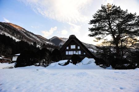 shirakawa go: Silhouette of ancient house Shirakawa go village in winter season Editorial