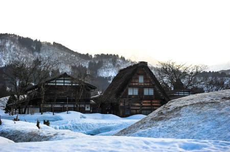 shrinkage: Silhouette of ancient wooden house Shirakawa go village in winter season
