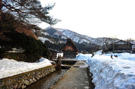 shirakawa go: Stone waterway in winter season of Shirakawa Go village