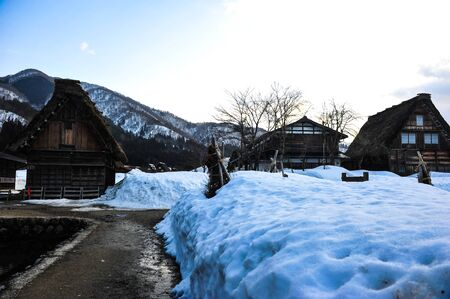 shrinkage: Snowy landscape and vintage house in Shirakawa Go village Editorial