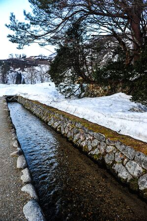 shrinkage: Small ancient waterway in old village of Japan