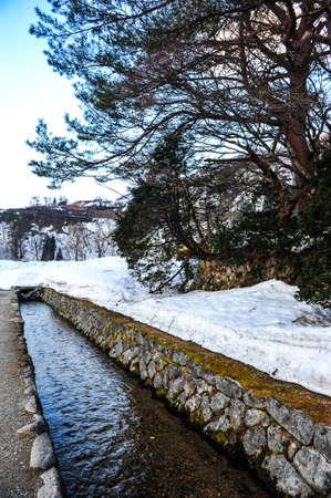 shrinkage: Small canal in winter season of Shirakawa Go village,Japan Stock Photo