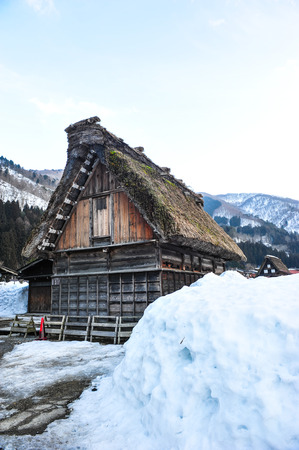 Beautiful old wooden house and snow wall Editorial