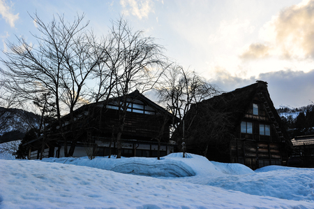 shrinkage: Silhouette of triangle roof of wooden house Shirakawa go village