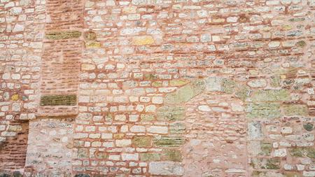 Ancient pink stone wall at the Hagia Sophia - Istanbul, Turkey