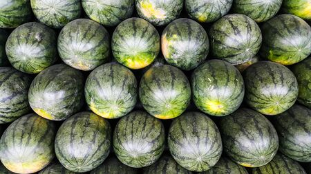 Overlapping of watermelons for sale in the market,Thailand Stock Photo - 86674310
