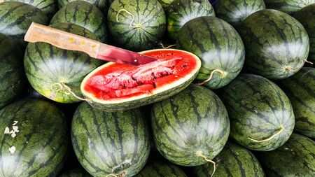 Knife on the watermelon half cut Stock Photo - 86674321