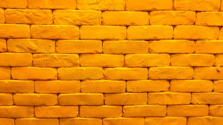 Yellow brick wall with lighting Stock Photo
