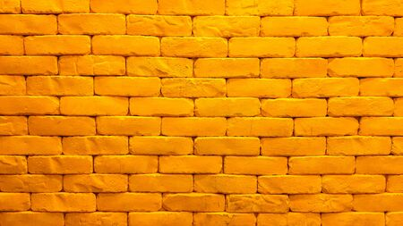 Interior design of yellow brick wall with lighting