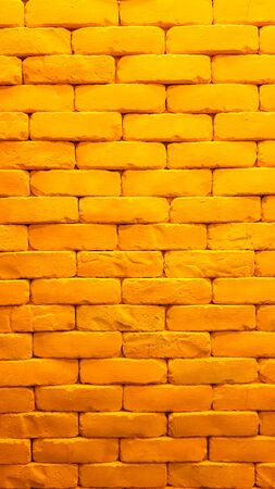 Fresh of yellow brick wall in the old house