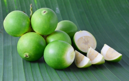 Betel palm on bananan leaf photo