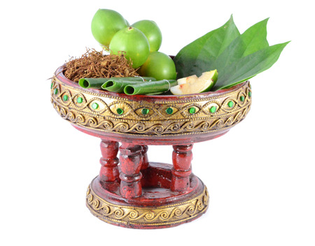 Areca nut, betel nut chewed with the leaf is mild stimulant. photo