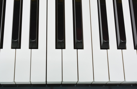 Shiny piano keys on grand piano  photo