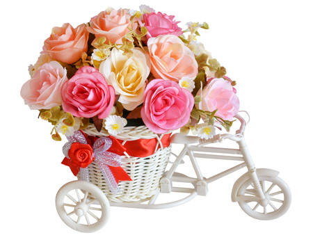 artificial flowers in basket isolate on white photo