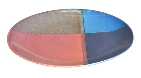 Multi-colored ceramic plates isolated on the white background photo