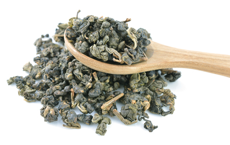 Heap of dry tea  Isolated on white background photo